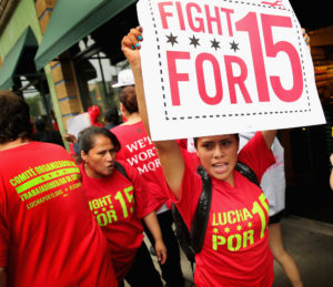 Employees and union activists protest low wages